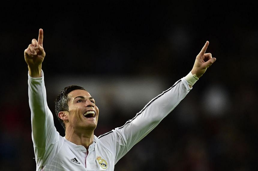 Real Madrid's Portuguese forward Cristiano Ronaldo celebrates after scoring in Madrid on Dec 6, 2014. Ronaldo netted a record 23rd hat-trick in La Liga and his 200th goal in the Spanish top flight as Real Madrid equalled a Spanish record of 18 consec