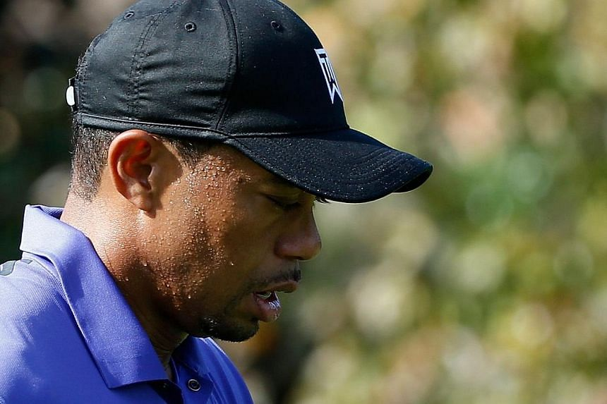 Tournament host Tiger Woods (above) battled a case of nausea as he soldiered through the third round's front nine in one under par at the Hero World Challenge on Saturday. -- PHOTO: AFP