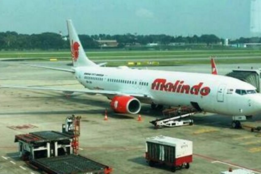 Malindo Air's plane parked in Changi Airport. The Malaysia-basedairline was officially welcomed at Changi Airport on Monday morning to mark their recent launch of daily flights between Kuala Lumpur and Singapore. -- PHOTO: MALINDO AIR/FACEBOOK