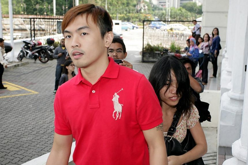 Malaysia's Immigration Department has revoked the passport of sex blogger Alvin Tan (in red) and activist Ali Abd Jalil, both of whom have sought refuge in foreign countries. -- PHOTO: THE STAR