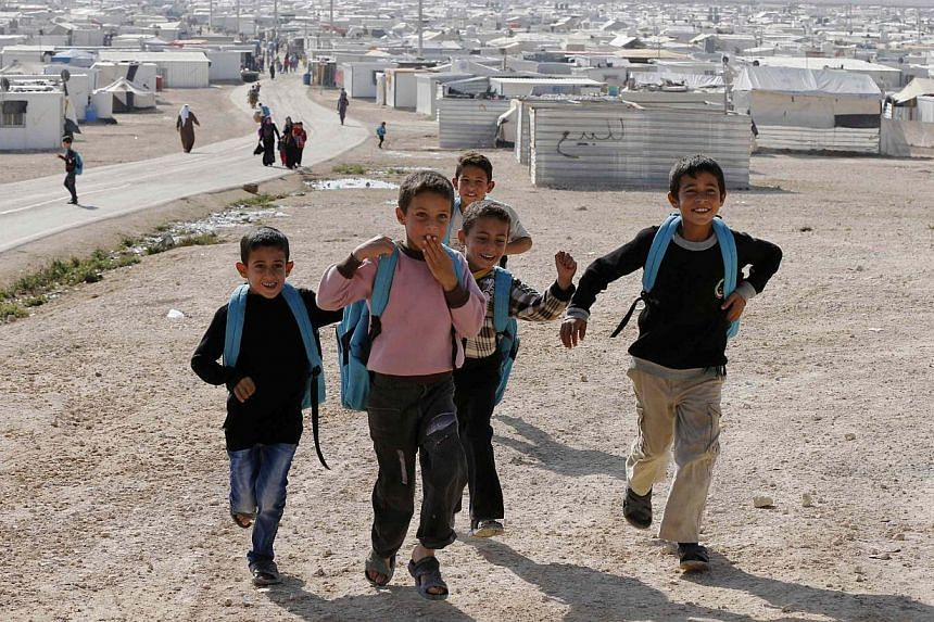 Syrian refugees play at the Al Zaatari refugee camp in the Jordanian city of Mafraq, near the border with Syria. More than 30 humanitarian organisations launched an appeal on Monday for countries to take in around 180,000 refugees from the Syrian con