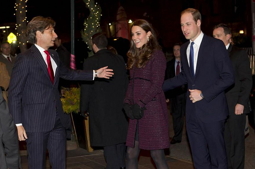 Britain's Prince William, Duke of Cambridge, and his wife Catherine, Duchess of Cambridge, are greeted by Carlyle hotel manager Giovanni Beretta as they arrive in New York, on Dec 7, 2014. -- PHOTO: AFP