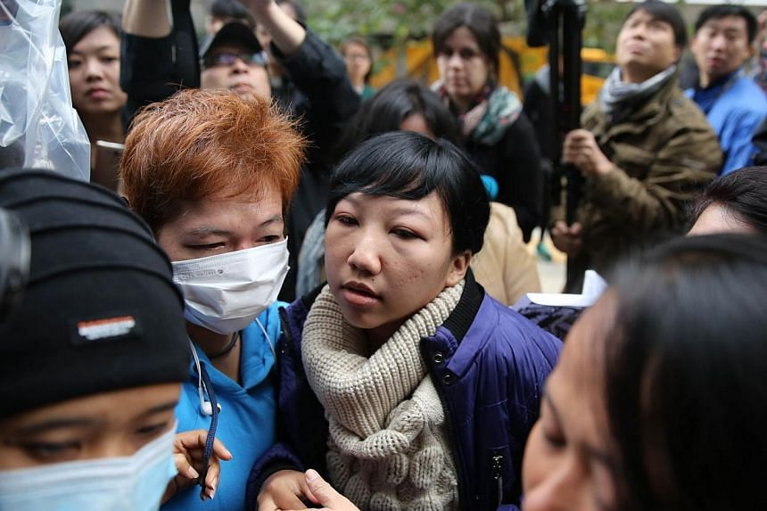 Erwiana Sulistyaningsih arrives at the Wanchai Law Courts to begin giving evidence against her former employer who is accused of abuse and toture in Hong Kong on Dec 8, 2014. -- PHOTO: AFP