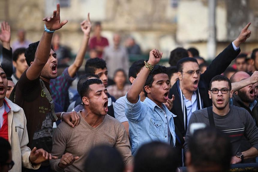 Egyptian protersters shout slogans on Abdel Moneim Riad Square in the capital Cairo on Dec 5, 2014, during a demonstration against a court's decision to drop a murder charge against ousted president Hosni Mubarak.The Canadian Embassy in Cairo w