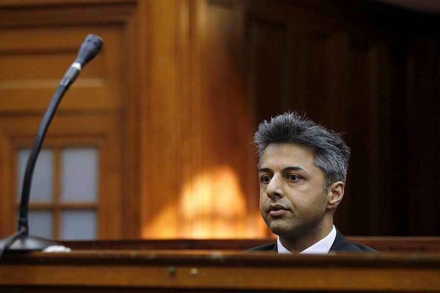 Honeymoon murder accused Shrien Dewani sits in the dock before the start of his trial in Cape Town, on Oct 6, 2014. A South African court acquitted Briton Shrien Dewani on Monday, clearing him of charges he paid hitmen to kill his wife while on