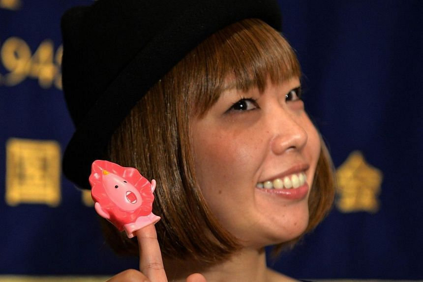 This file picture taken on July 24, 2014 shows Japanese artist Megumi Igarashi, who calls herself Rokude Nashiko at a news conference in Tokyo.A sex shop owner arrested along with Ms Igarashi, who makes objects shaped like her own vagina, has b