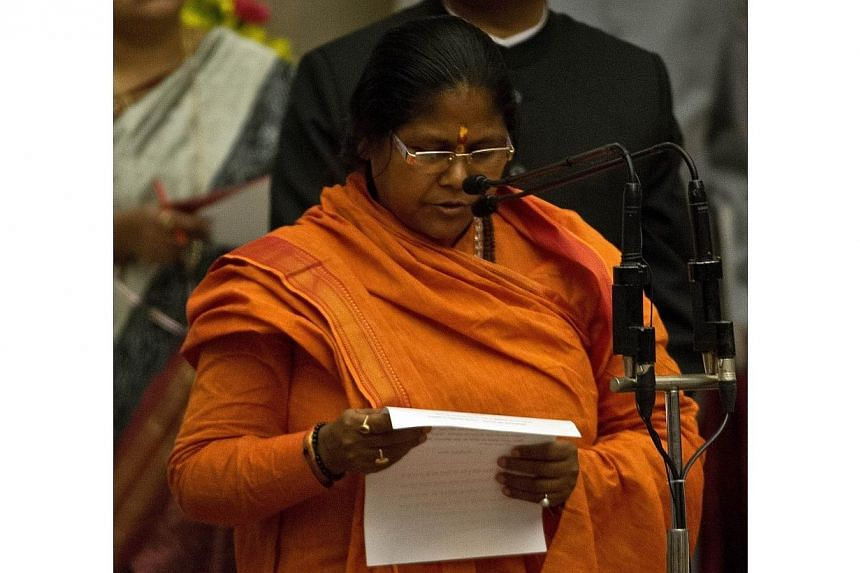 Bharatiya Janata Party leader Sadhvi Niranjan Jyoti takes an oath during a swearing-in ceremony at The Presidential Palace in New Delhi on Nov 9, 2014. India's parliament returned to business on Monday after the opposition dropped its demand for