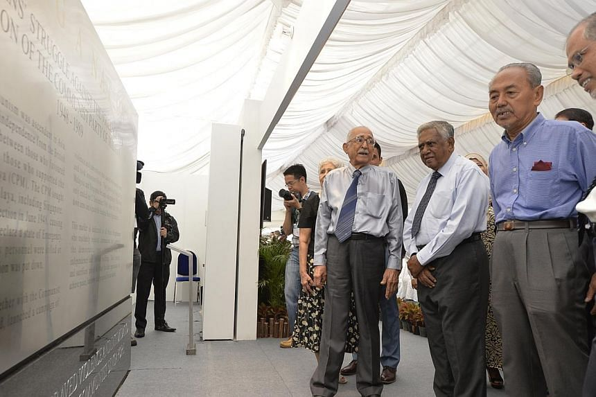 Former president SR Nathan (third from right) launched a commemorative marker at the Esplanade Park on Dec 8, 2014, to remember Singapore's fight against Communism.-- ST PHOTO: DESMOND FOO
