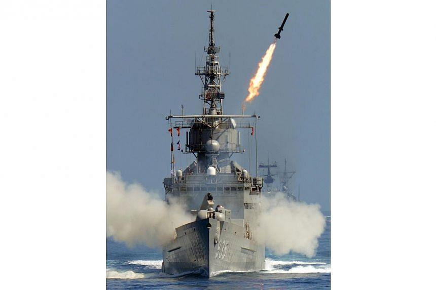 A rocket fires from a US-made Perry-class frigate during the Han Kuang drill at sea neat eastern Hualien on Sept 17, 2014.China's foreign ministry rebuked the US Congress on Monday after legislators passed a Bill allowing the sale of second-han