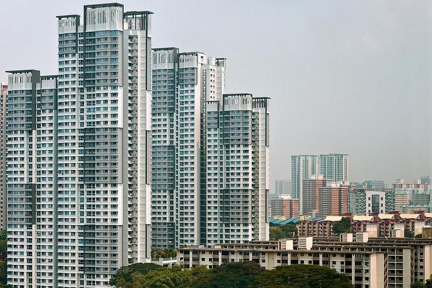 HDB blocks in Tanglin Halt. Owners residing in Housing Board flats will enjoy a reduction in their property tax in 2015 compared to this year, said the Inland Revenue Authority of Singapore on Monday. -- ST PHOTO: CAROLINE CHIA
