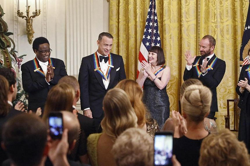 This year's Kennedy Center honorees (from left ) singer Al Green, actor Tom Hanks, ballerina Patricia McBride, singer Sting and comedienne Lily Tomlin at a reception in the East Room at the White House in Washington on Dec 7, 2014. -- PHOTO: REUTERS