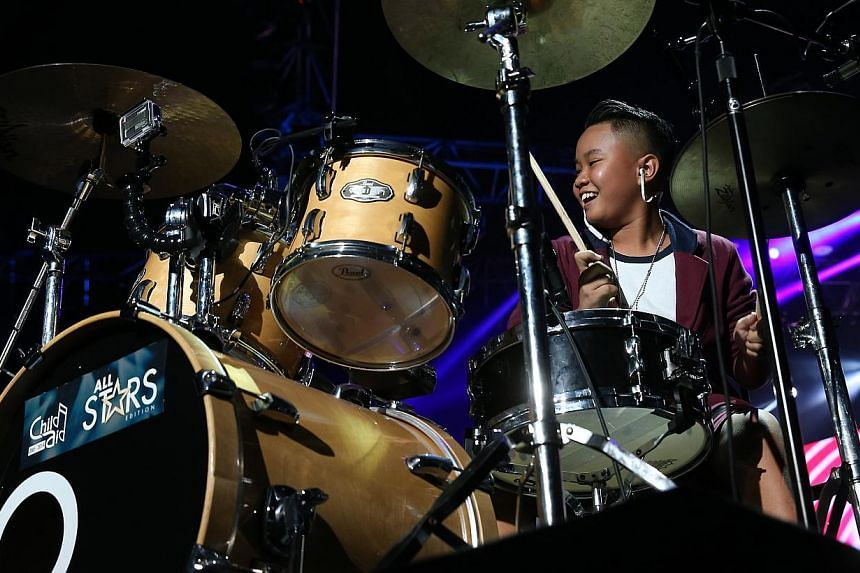 Fourteen-year-old Zidann Zalizan (above) was part of a drumming group which performed Cantaloupe Island and Samba de Janeiro. Soprano Janani Sridhar, 24, thrilled concertgoers with her rendition of O Mio Babbino Caro.