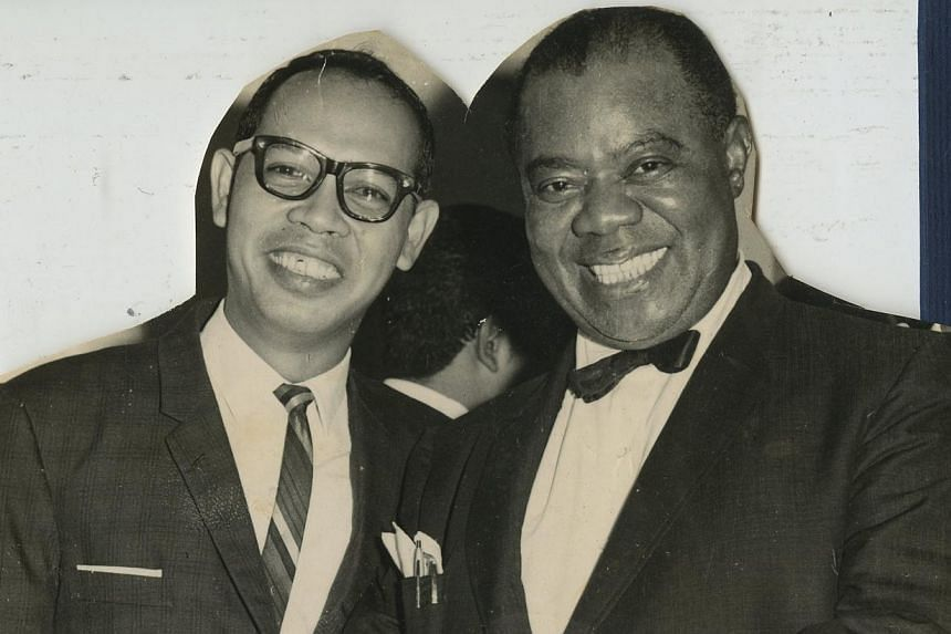 Composer Rufino Soliano at age four (left). He has played with international legends such as Louis Armstrong in the mid-1960s (above). Soliano with Prime Minister Lee Hsien Loong at a pioneer generation event at the Istana early this year (left) and