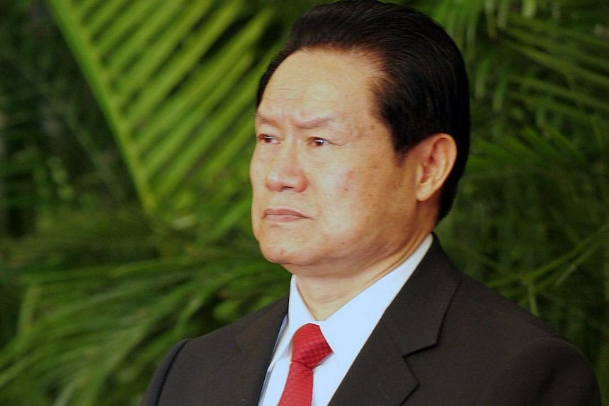 Mr Zhou Yongkang, 72, faces a judicial probe for a slew of charges, including taking bribes, helping family members and cronies plunder government assets, and leaking official secrets, according to the official Xinhua news agency. -- PHOTO: CHIN