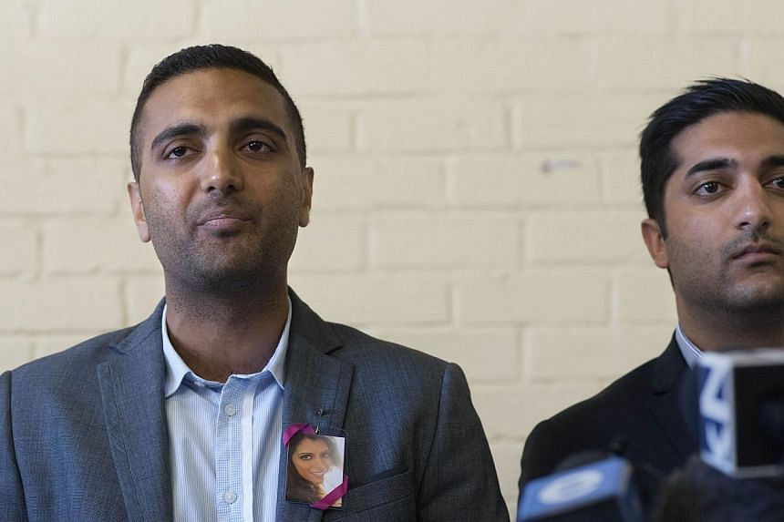 Anish Hindocha (left), wears a pin with a picture of his sister Anni Dewani who was murdered in 2011, as he speaks during a press conference in Cape Town on Dec 3, 2014, flanked by his cousin, introduced as Nikesh Hindocha. -- PHOTO: AFP