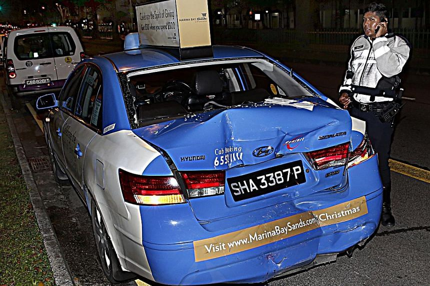 Thirteen people were injured after an accident between a bus and a taxi along Upper Serangoon Road on Monday night. -- ST PHOTO:LAU FOOK KONG