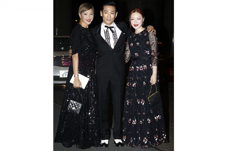 Singer Alex To arrives with his wife Ice Lee (right) and former actress Anna Ueyama. Ueyama, formerly known as Anna Kamiyama, and Carina Lau were TVB stars in the 1980s. -- PHOTO: APPLE DAILY