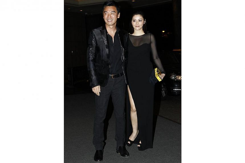 Singer Kenny Bee and his wife Fanchiang Su-chen - a close friend of Carina Lau. -- PHOTO: APPLE DAILY
