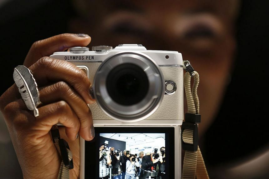 A former brokerage executive who helped camera giant Olympus cover up years of huge financial losses was given a suspended jail sentence on Monday, Dec 8, 2014. -- PHOTO: REUTERS