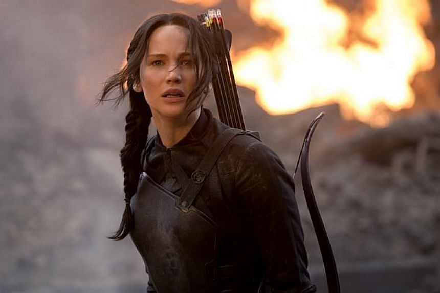 North American audiences continue to feast on The Hunger Games sequel Mockingjay Part 1, starring Jennifer Lawrence. -- PHOTO: CATHAY-KERIS FILMS