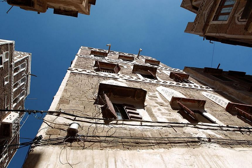 The building that US photojournalist Luke Somers, killed during a failed attempt by US special forces to free him from Al-Qaeda militants, lived in is seen in the the old city of Sanaa Dec 7, 2014. Villagers say at least 11 people, including a 10-yea
