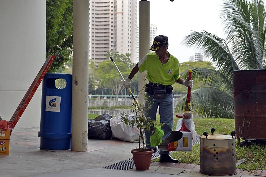 From Jan 1, residents across the island will all pay the same fee for rubbish collection, as the last remaining four sectors join the National Environment Agency's (NEA) uniform fee scheme. -- PHOTO: ST FILE
