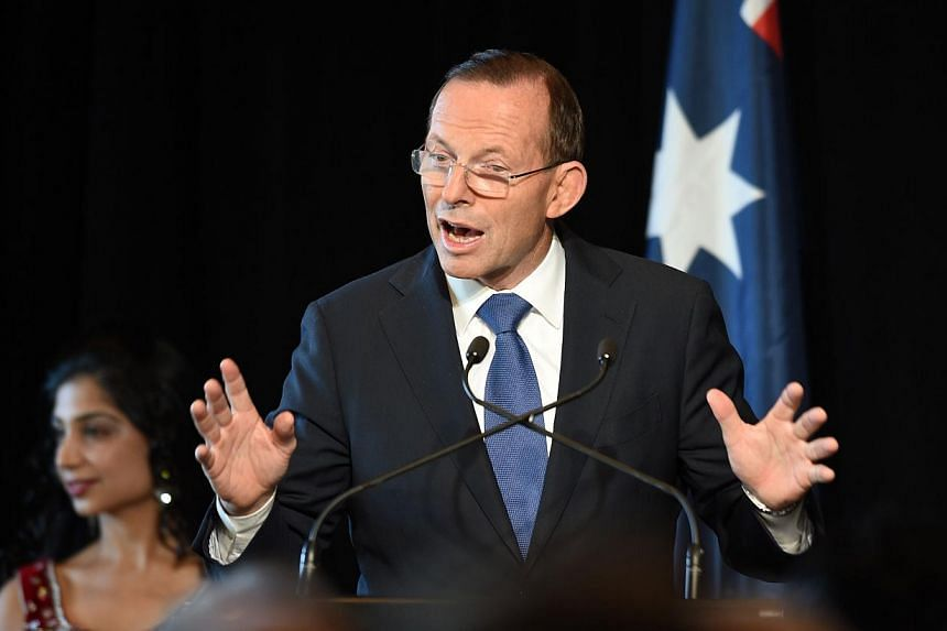 A poll in Fairfax Media showed Abbott's personal approval rating is down to 38 per cent from the last survey five weeks ago, while Labor opposition leader Bill Shorten has jumped to 46 per cent. They were previously level-pegging. -- PHOTO: AFP