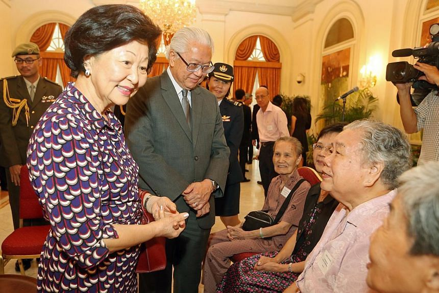 President Tony Tan Keng Yam and wife Mary Tan hosted tea for 60 volunteers including those from the elderly sector like (from right) Yoong Lin Heng, 76 (NTUCHealth Silverace@Redhill), Cheng Lai Woh, 81 (NTUCHealth Silverace@Redhill), Lim Tai Foon, 62