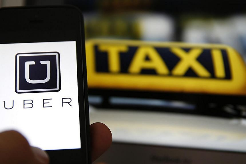 Dutch judges on Monday banned the popular ride-sharing service UberPOP from taking bookings via its smartphone app, threatening US company Uber with fines of up to 100,000 euros (S$162,145). -- PHOTO: REUTERS