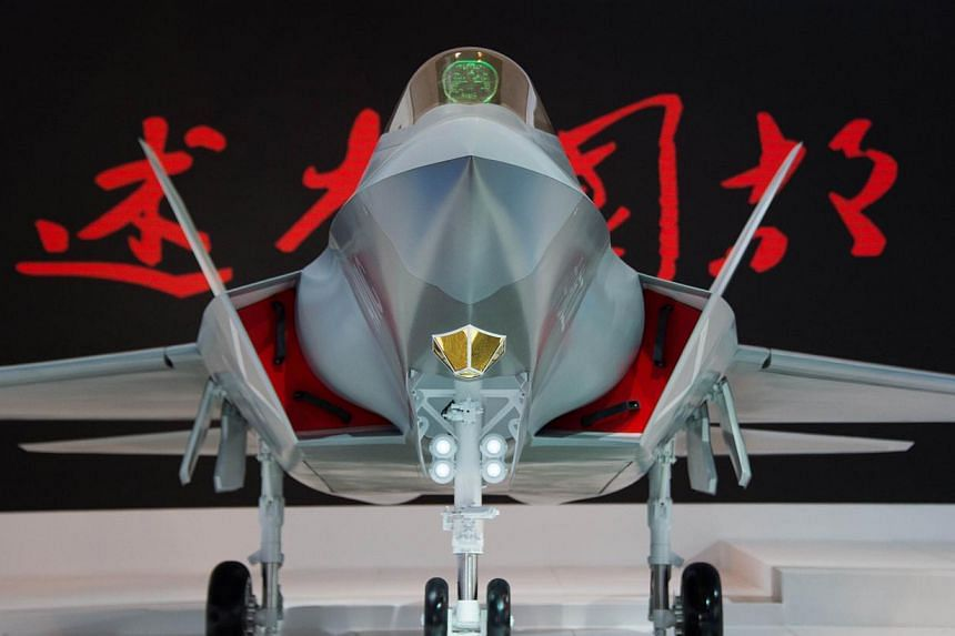 A model of a Chinese J-31 stealth fighter of AVIC is pictured at the Airshow China 2014 in Zhuhai, south China's Guangdong province on Nov 12, 2014. -- PHOTO: AFP