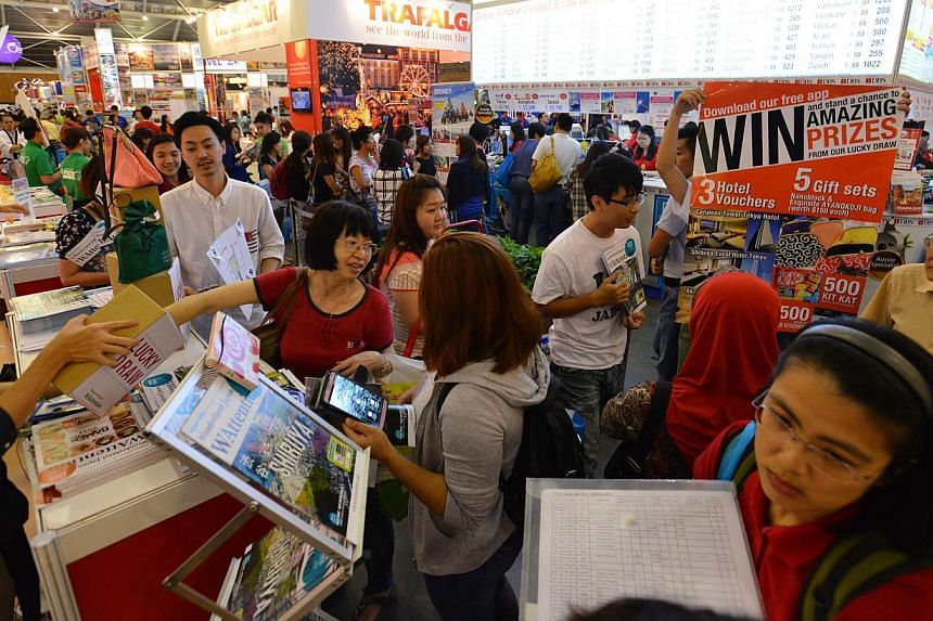 People at the Natas Holidays travel fair held in August 2014 at the Singapore Expo. -- PHOTO: ST FILE