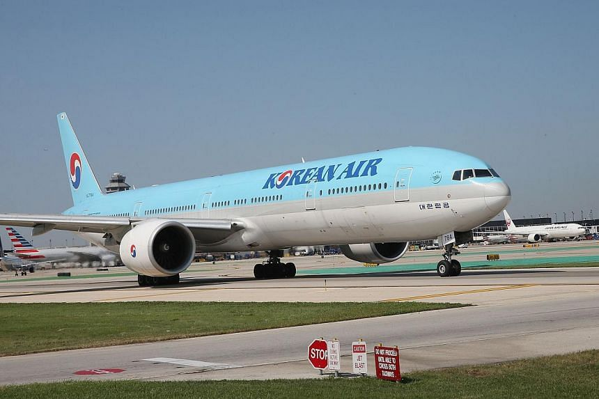 Korean Air apologised as it faced a media backlash over the daughter of the airline's chief executive, who had a chief purser ejected from a plane in a furious reaction to being incorrectly served some macadamia nuts. -- PHOTO: AFP