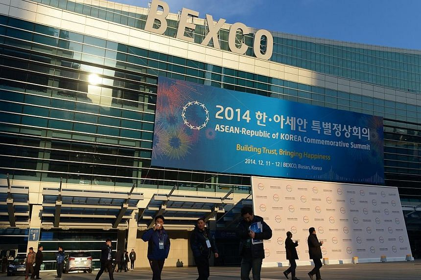 Securtiy personnel stand outside BEXCO, a convention and exhibition centre, in Busan, South Korea, in preparation for the Asean-ROK Summit happening between Dec 11-12. Prime Minister Lee Hsien Loong leaves for South Korea on Wednesday to the sum
