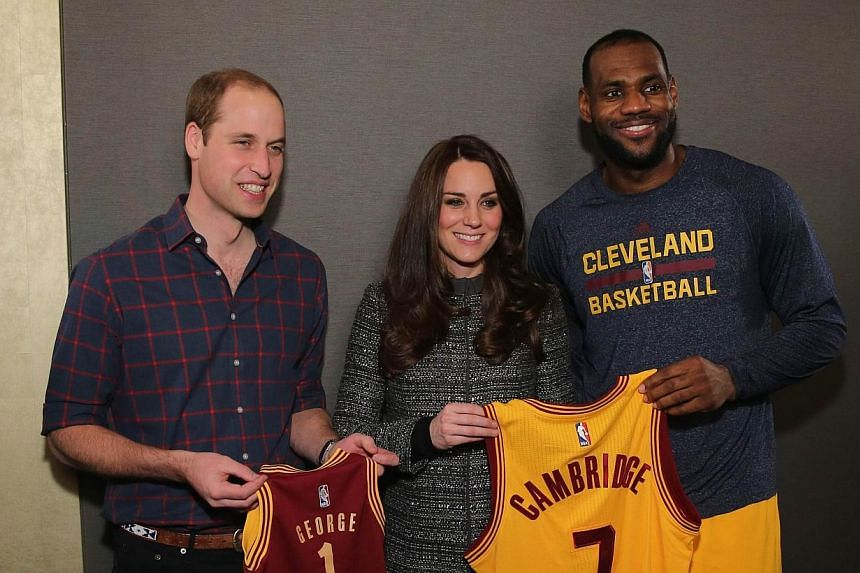 (From left) Prince William, Duke of Cambridge and Catherine, Duchess of Cambridge pose with basketball player LeBron James backstage as they attend the Cleveland Cavaliers v Brooklyn Nets game at Barclays Center on Dec 8, 2014 in the Brooklyn borough