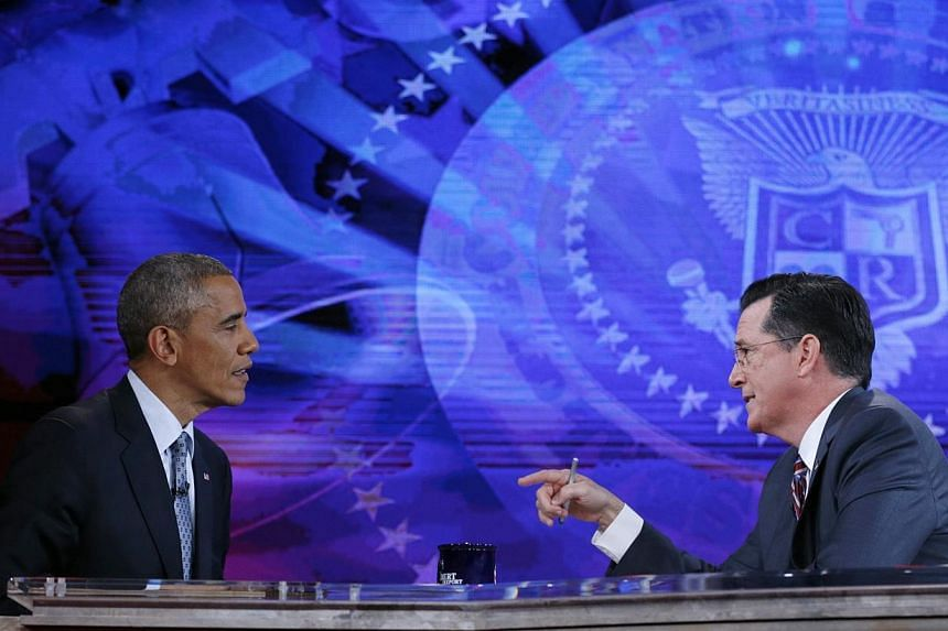 US President Barack Obama (left) appears on The Colbert Report with Stephen Colbert at the Lisner Auditorium at George Washington University in Washington on Dec 8, 2014. -- PHOTO: REUTERS
