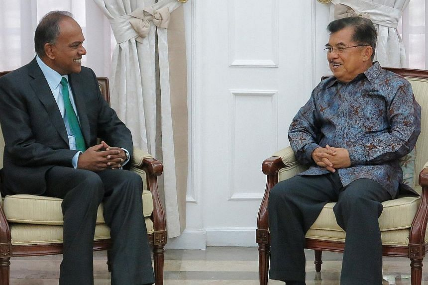Minister for Foreign Affairs and Law K Shanmugam (left) pays a courtesy call on Indonesian Vice President Jusuf Kalla in Jakarta, Indonesia. -- PHOTO: MINISTRY OF FOREIGN AFFAIRS
