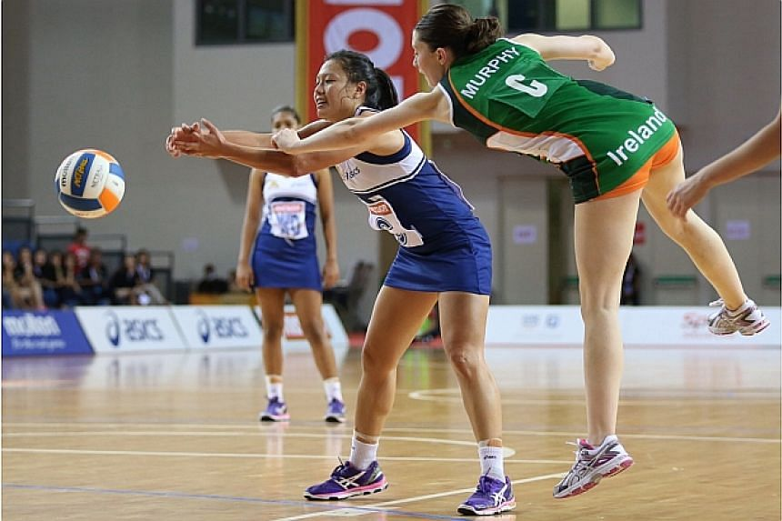 Singapore wins Ireland 47-20 in their third match of the Netball Nations Cup held at the OCBC Arena Hall 1 on Dec 9, 2014. -- ST PHOTO: NEO XIAOBIN