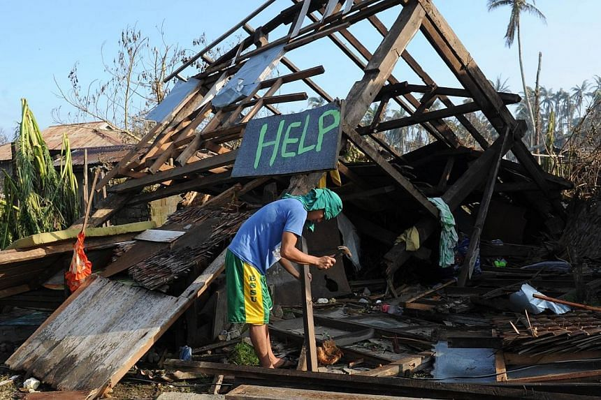 A resident trying to salvage materials from his house that was destroyed at the height of Typhoon Hagupit on Dec 9, 2014. Thestorm left the Philippines on Tuesday after killing at least 27 people and devastating remote coastal towns, but the go