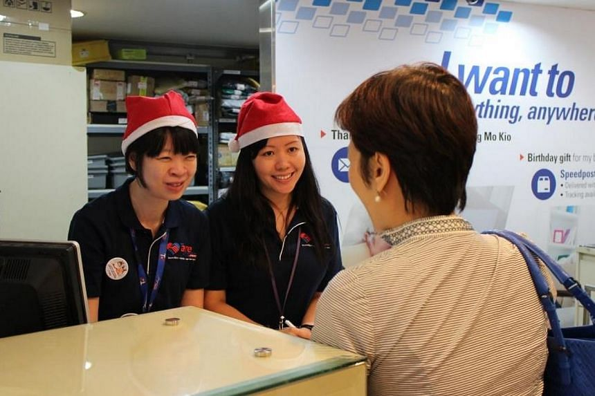 Over 320 of SingPost's management staff will help out at post offices this festive season. -- PHOTO: SINGPOST