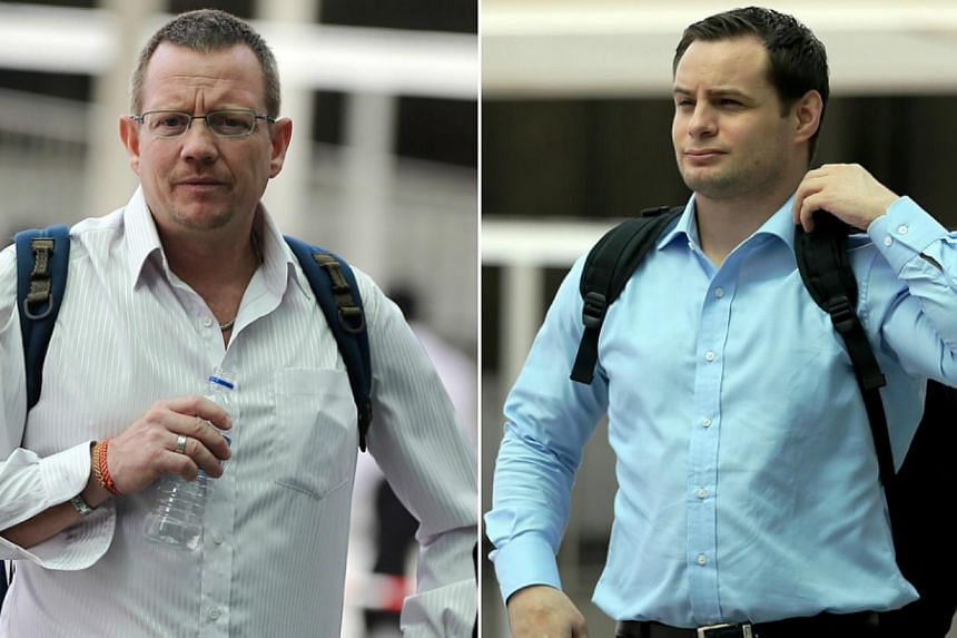 Three foreign nationals, including Arne Corneliussen (left) and Andreas Michel Blomqvist, were hauled to court on Tuesday over offences involving taxi drivers. -- ST PHOTOS: WONG KWAI CHOW