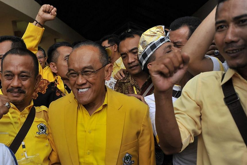 Indonesian tycoon Aburizal Bakrie (centre) is all smiles after winning another term as Golkar's chairman. The teflon-coated politician has survived various setbacks in a long and chequered career.