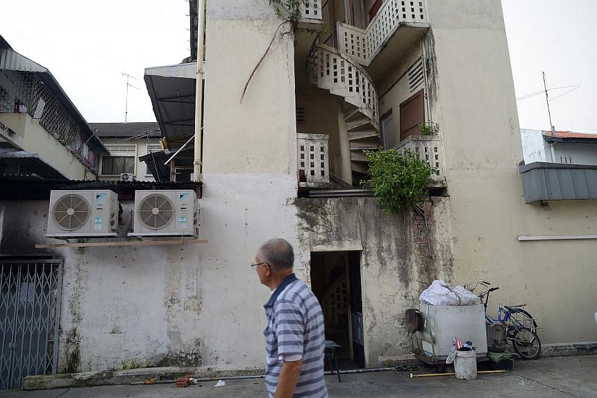 The back of the building in Geylang Lorong 4 where a fire broke out on the morning of Dec 6, 2014, killing four. -- ST PHOTO: DESMOND WEE