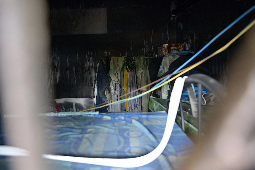 The interior of a room inside the burnt walk-up apartment at Geylang Lorong 4. -- ST PHOTO: DESMOND WEE