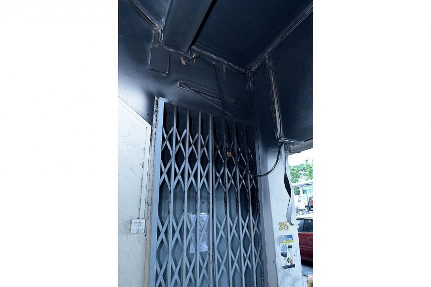 The doorway of the burnt walk-up apartment at Geylang Lorong 4. -- ST PHOTO: DESMOND WEE