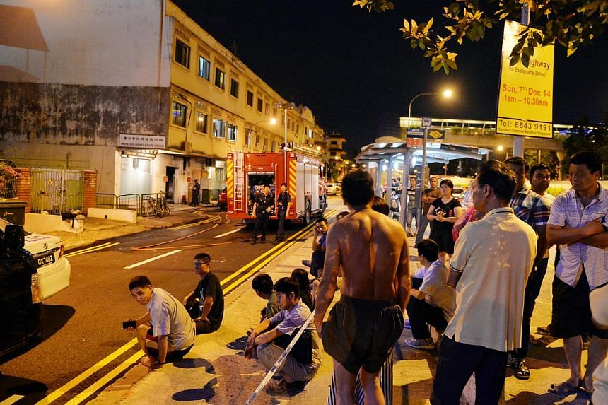 A fire engine is seen at the scene of the Dec 6, 2014 fire at Geylang Lorong 4 -- PHOTO: SHIN MIN