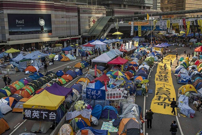 Banners and tents set up by pro-democracy protesters outside the government headquarters at Admiralty, Hong Kong, on Dec 8, 2014. -- PHOTO: REUTERS