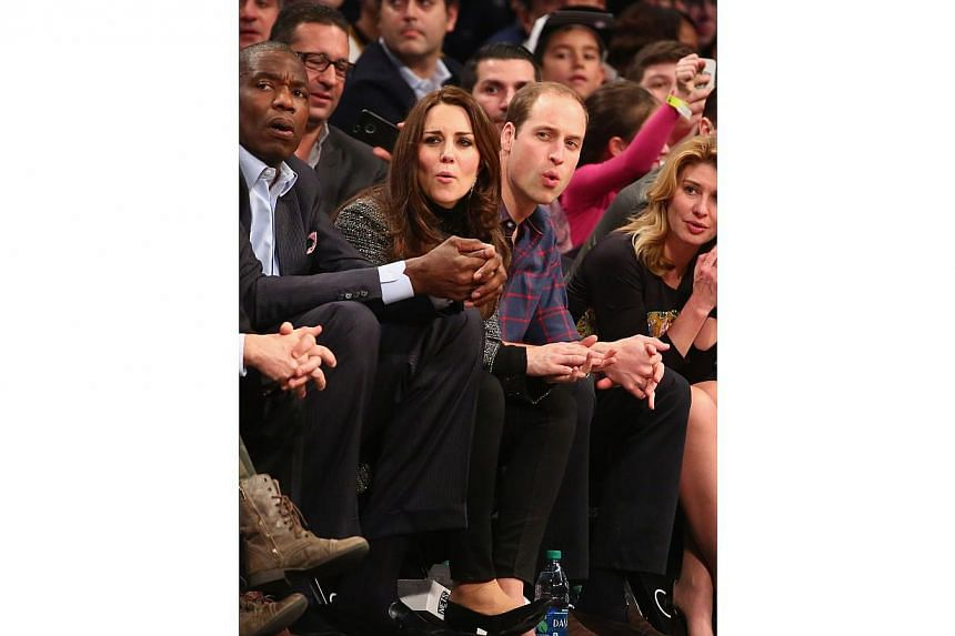 Prince William, Duke of Cambridge and Catherine, Duchess of Cambridge watch the game between the Cleveland Cavaliers and the Brooklyn Nets at Barclays Center on Dec 8, 2014 in the Brooklyn borough of New York City. -- PHOTO: AFP