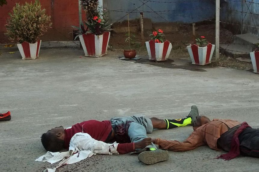 The bodies of Indian prisoners killed in a gun battle lie on the ground during an attempted jailbreak in Chaibasa in the state of Jharkhand on Tuesday. Police shot dead at least two prisoners as they sought to flee custody. The prisoners staged the g