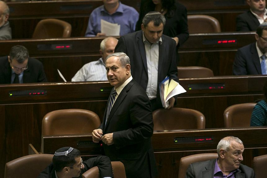 Israel's Prime Minister Benjamin Netanyahu leaves after a vote to dissolve the Israeli parliament, also known as the Knesset, in Jerusalem on Monday. Israel's parliament voted on Monday to dissolve itself in preparation for an early general election