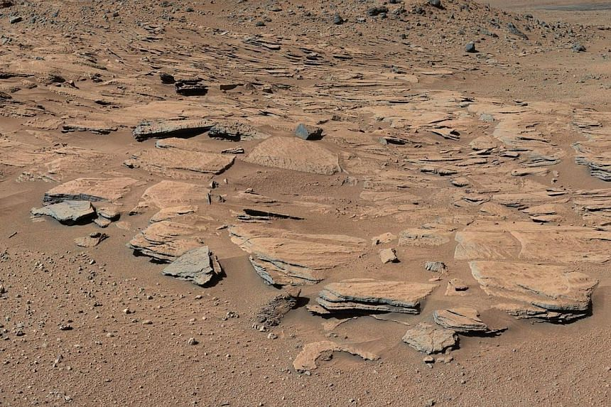 This NASA handout photo shows beds of sandstone inclined to the southwest toward Mount Sharp and away from the Gale Crater rim. NASA scientists who have been studying observations from the Curiosity rover scouring the Red Planet, announced Monday tha